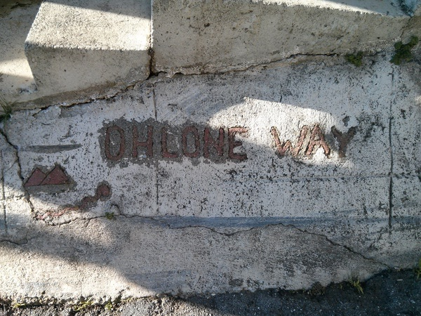 Ohlone Way sign, marked by the entrance in concrete